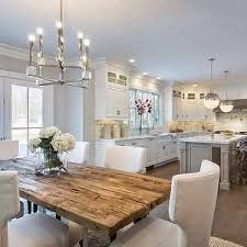 layout l shaped kitchen with island and eat in table at back