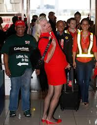 airasia uniform sir richard branson dresses up as air stewardess after losing bet to