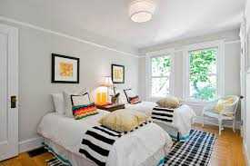 Decorating Guest Bedroom - clean white themed eclectic kids bedroom using guest bedroom