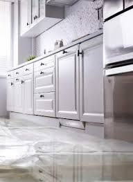 how to fix cabinet bottom how to kitchen cabinets cupboards drying water damage