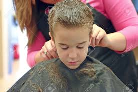 little boy getting a hair cut stock photo picture and royalty