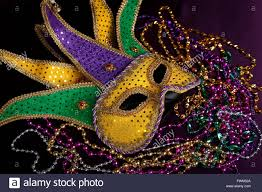 green mardi gras mask a mardi gras jester s mask with purple gold and green on a