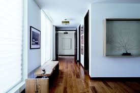 four bedroom penthouse with den dorado beach a ritz carlton hallway with hardwood floors and framed artwork on the walls