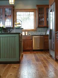 kitchen floor hardwood floor and medium wood tone cabinets and