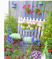 Pinterest Gardening Crafts - your own cottage garden with recycled windows and fence surrounded