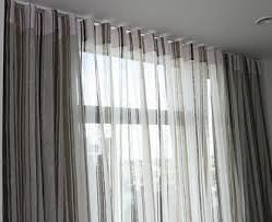sheer curtain in the front and blackout drapery behind them great