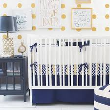 beautiful nursery features mustard yellow polka dot walls lined
