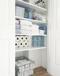 Organizing A Small Bathroom - linen closet organizing create more storage organizing linens