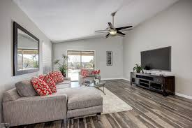 contemporary livingroom contemporary living room with hardwood floors carpet in