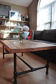 wood top coffee table metal legs like the idea of rustic wood table top industrial legs for dining