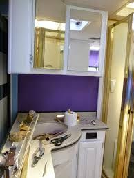 purple goddess in frog pyjamas rv paint job bathroom vanity area