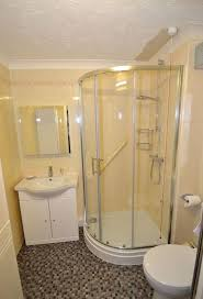 bathroom tiles for small bathrooms ideas photos small bathrooms with corner showers with glass door partitions and