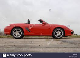 Porsche Boxster Red - red 2007 porsche boxster convertible german sports car stock photo