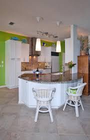 duraceramic kitchen with ceramic tile floor granite green
