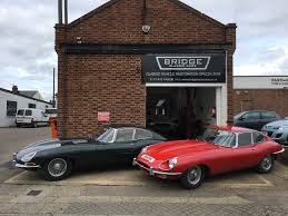 golden fast cars jaguar e types outside bridge classic cars bridge classic cars