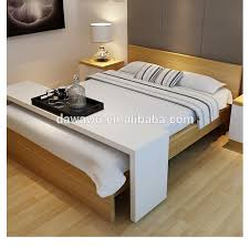 bed table on wheels white high gloss lacquering wooden bed table with wheels buy bed