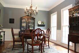 blue dining room with brown and black accents eclectic dining room