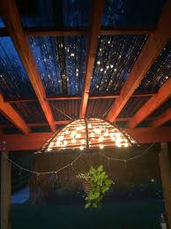 papason chair turned to chandelier for the yard pinterest papason chair turned to chandelier papasan