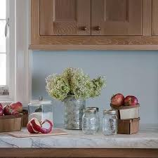 blue kitchen walls with brown cabinets brown kitchen cabinets blue walls design ideas