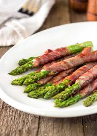wrapped asparagus with prosciutto and kevin is cooking
