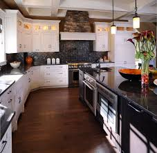 white kitchen cabinets with dark granite countertops precious home