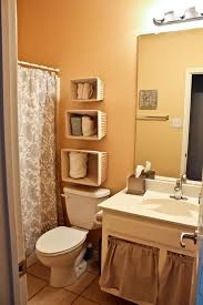 ideas for towel storage in small bathroom bathroom white painted elongated toilet light brown