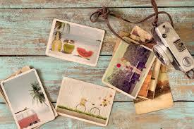 honeymoon photo album photo album of journey honeymoon trip in summer on wood table