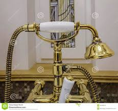 gold bathtub faucets and shower head stock photo image 48700701