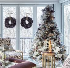 pretty christmas trees traditional home here s another example of a lovely tree dressed in its room s palette purple and gold ornaments plus the purple wreaths go hand in hand with the lavender