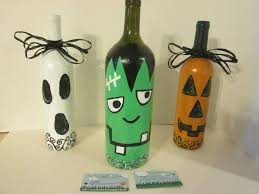 bows for wine bottles trio of painted wine bottles with black bows ghost