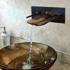 bathroom wall mount waterfall faucet made from rubbed bronze with
