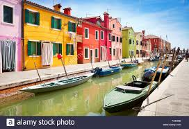 colored houses in the burano village near venice italy stock