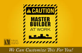 master builder at work with building bricks caution sign wall