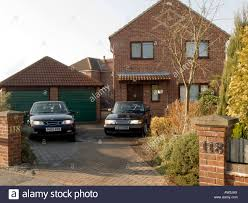 suburbian house suburb surburbia home two 2 car garage saab stock