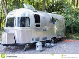 vintage airstream trailer on campsite editorial stock image