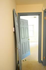 painting doors and trim different colors priming and painting our trim and doors with a paint sprayer young