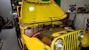 old yellow jeep classic jeep cj5 converted to electric gas 2