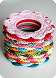 crochet bands use hair rubber bands to make these crocheted hair scrunchies no