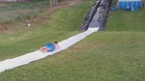 Backyard Slip N Slide Adventurous Man Learns To Fly On Slip N Slide Tiphero