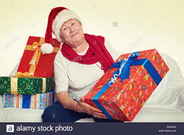 what to get an elderly woman for christmas elderly woman with christmas box gift happy concept