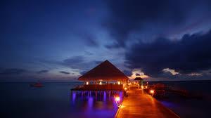 night lights maldives tropical beach bungalow ocean sea sunset