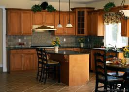 wood kitchen ideas black kitchen counter with black cup pulls on medium wood cabinets