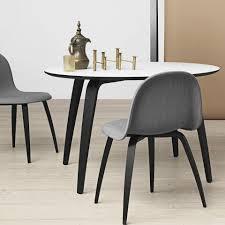 gubi round table by komplot surrounding