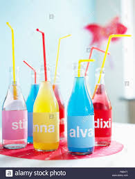 birthday drink bottles of coloured soft drinks name labels for child u0027s birthday