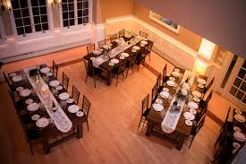 rustic wedding venues island rock island lake club ballroom farm tables centerpiece inspiration