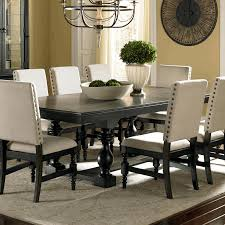 sullivan round dining table ivory painted dining table fake flowers in vase zinc top round table