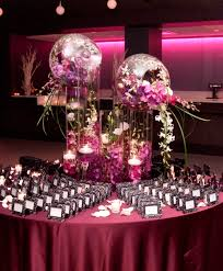 Table Decorations For Wedding by Glass Cylinder Decorations Overflowing With Exotic Flowers The