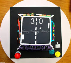 birthday cake w old video games on each side geekologie