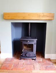 aga stove with oak beam and brick hearth cambridge stoves