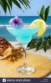 blue hawaiian cocktail blue hawaiian cocktail on the tropical beach iced blue